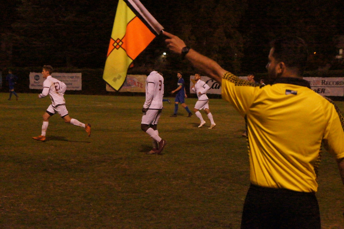 A referee signals possession of the ball while both Chico State and Cal State San Marcos get ready for the ensuing play on Thursday. Photo credit: Keelie Lewis
