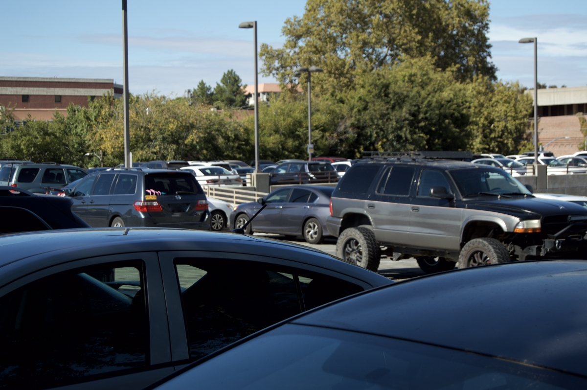 The parking lot across from the Wildcat Recreation Center is full of cars on a Tuesday afternoon. Photo credit: Daelin Wofford