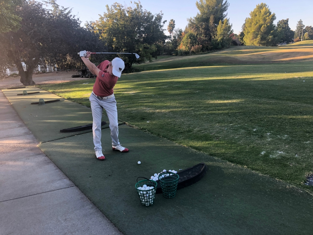 Chico State golfer Kelley Sullivan takes some practice drives. Photo credit: Connor Mcpherson