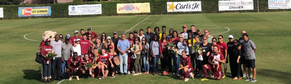 Chico State seniors and their families pose for a picture before the game against UC San Diego on Saturday. Photo credit: Connor Mcpherson