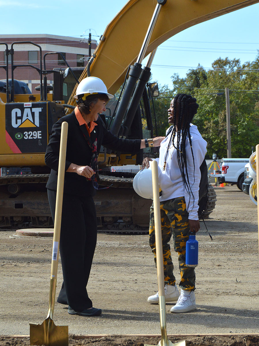 President Gayle Hutchinson and Marqia Smith share a moment of celebration of the new science building groundbreaking ceremony on Wednesday. Smith was walking by the ceremony when President Hutchinson invited her to grab the last shovel and hard hat and break ground for the new building alongside her. Photo credit: Olyvia Simpson