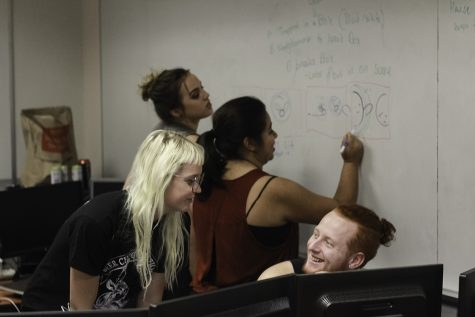 Sam, Nicole Martinez, Shannon Hanson, and Marissa Winslow create storyboards for their animation. Photo credit: Tara Killoran