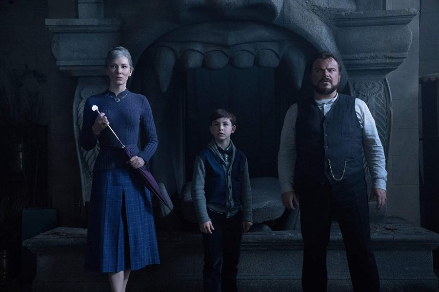 Lewis (Owen Vacarro, center) with his uncle, Jonathan (Jack Black, right) and the neighbor witch, Florence (Cate Blanchett, left) in