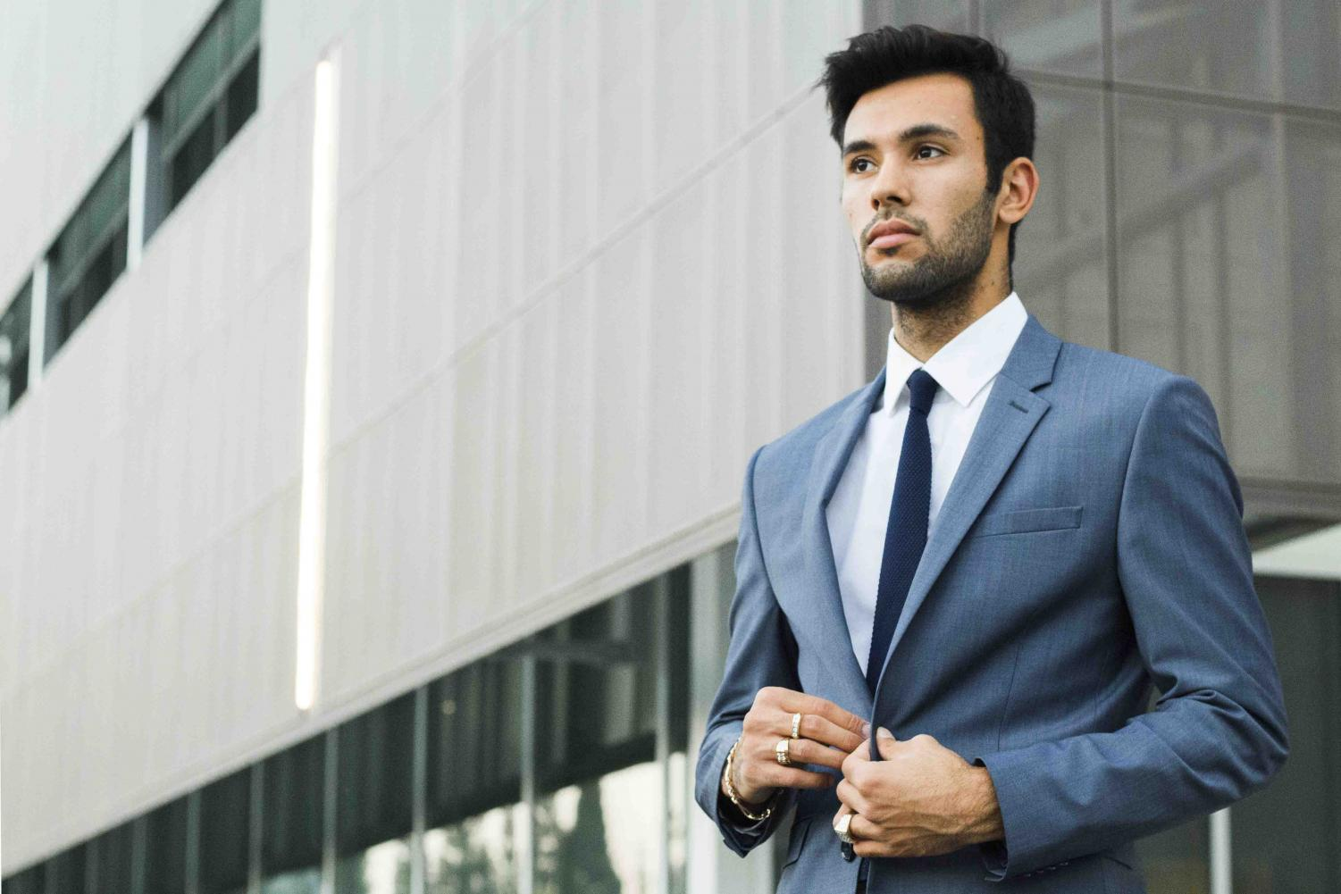Johan Lozano poses in a full suit and tie. Dressing professionally helps to create a great first impression on potential employers. Clothing is not from JCPenney.