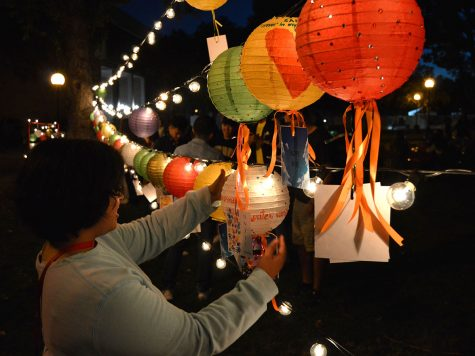 Marifer Martinez places the lantern she decorated to the lights string. Photo credit: Olyvia Simpson