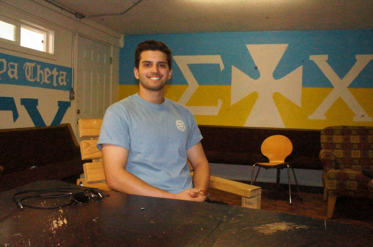 Chris Laverrite inside of the Sigma Chi chapter house. Photo credit: Keelie Lewis