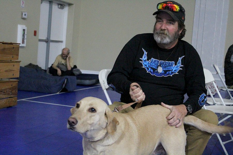 Sam Zuckerman evacuated with his friend and his friend's Molly on Thursday. Pleasant Valley Baptist Church accepts animals and has plenty of room for people.