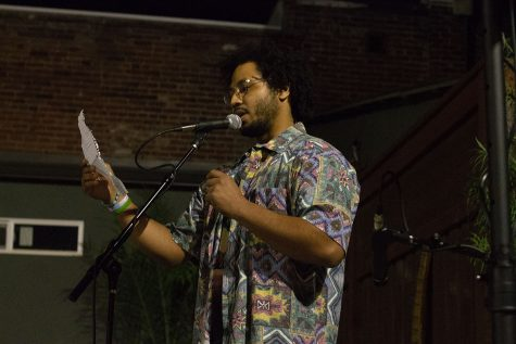 "$aint recites a poem at the ""Love Is"" Acoustic showcase, check out the article in this week"