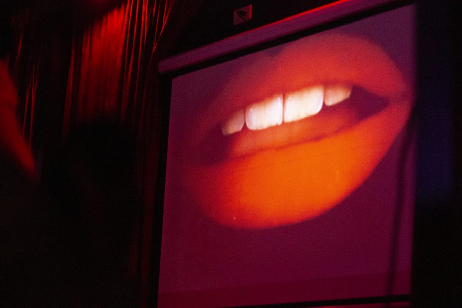 Patricia Quinn (Magenta) lips grace the screen at the beginning of the movie during the Rocky Horror Picture Show viewing at the Maltese on Halloween. Photo credit: Dominique Wood