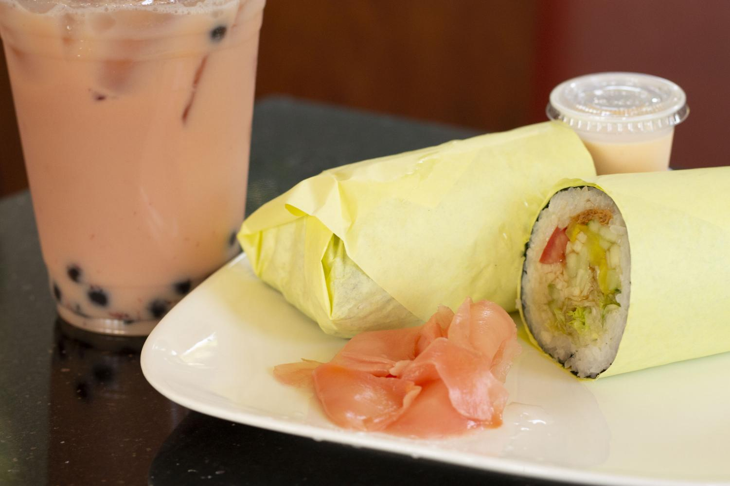A sushi burrito comes with spicy mayo, wasabi cream, and pickled ginger. Enjoy a strawberry milk tea with boba as well. Photo credit: Dominique Wood