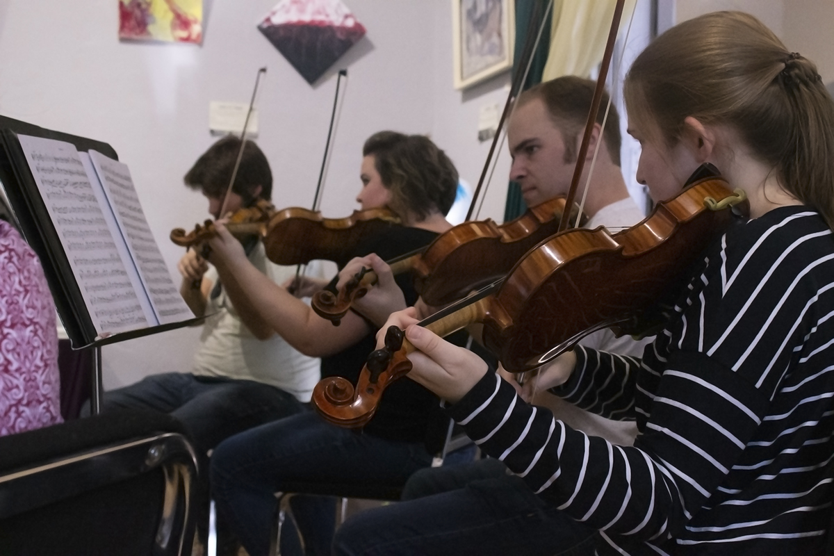 A portion of the violin section of the North State Symphony at the Museum of Northern California Arts on Saturday. Photo credit: Dominique Wood
