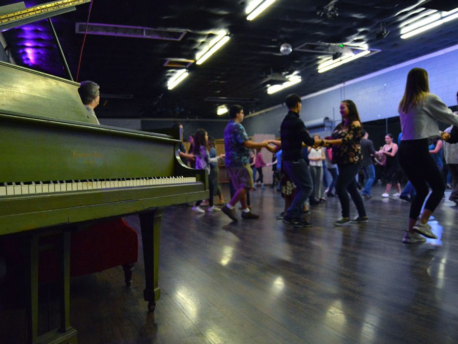 Students practice the one, two, three; five six, seven-step process for salsa dancing. Photo credit: Olyvia Simpson