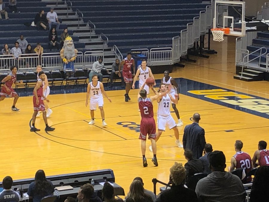 Chico State Guard Calvin Geraci (red) pulls up for the three over UCSD forward Eric Patton (white) during the second half of a game on Saturday. Photo credit: Connor Mcpherson