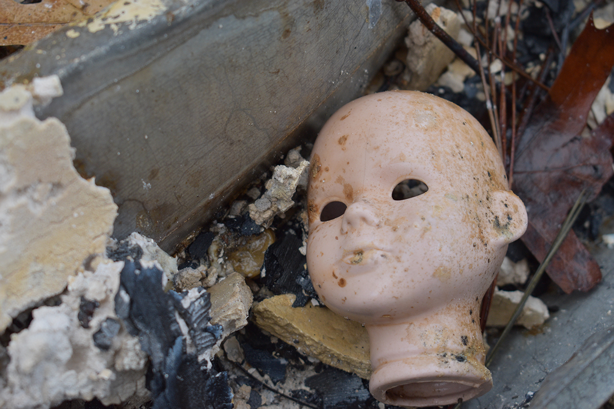 The Camp Fire burned almost everything in it's path, yet some household items like this baby head doll survived the flames.