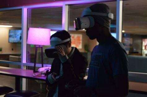 Carlos Pioroda and Kendrick Short experiencing VR gaming Night in the basement of the BMU. Photo credit: Daelin Wofford