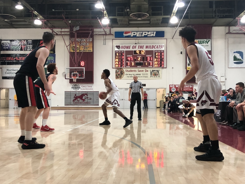 Kevin Warren and Isaiah Brooks operating the Chico State offense against Cal State East Bay on Saturday. Photo credit: Wesley Harris
