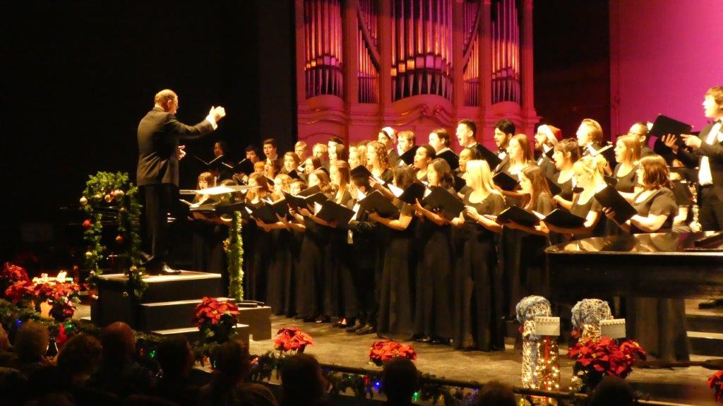 The vocal groups sing carols to start the concert, conducted by Dr. Scholz. Photo credit: Josh Cozine