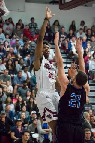 Sophomore Justin Briggs avoids defense and finds an open shot in a Chico's playoff matchup against Cal State San Bernardino last season in this archived image. Photo credit: Kate Angeles