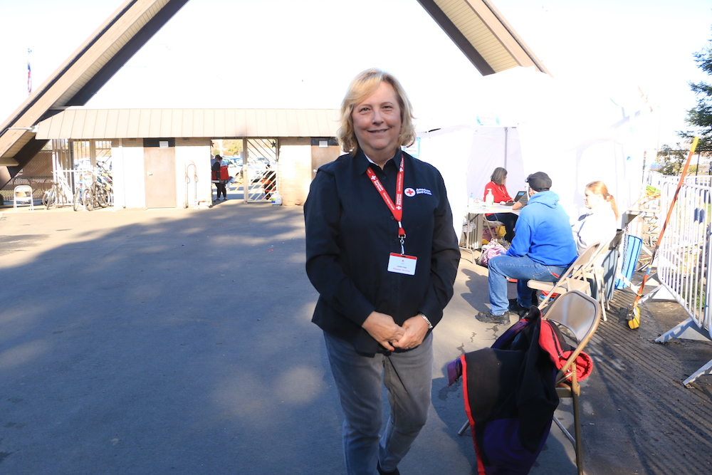 Cindy Huge is a Red Cross volunteer who has worked at 24 national emergency shelters.  She is currently stationed in Chico as part of public affairs for the Camp Fire shelter. Photo credit: Melissa Herrera