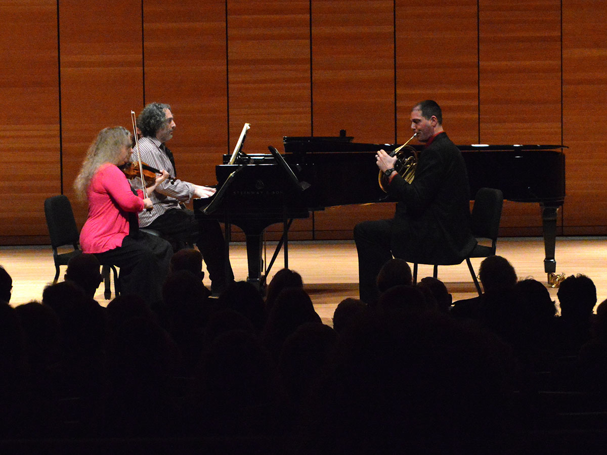 "Terrie Baune, John Chernoff and Dan Nebel perform Horn Trio in E Flat major. ""The horn isn't typically an accompaniment of piano and violin,"" Nebel said, but the French Horn addition enhanced the composition of the piece. Photo credit: Olyvia Simpson"
