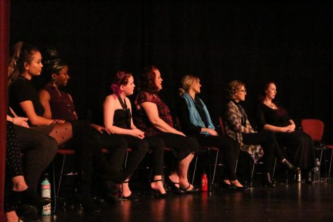 Cast Members of the Vigina Monologues sitting down while on stage. Photo credit: Rayanne Painter