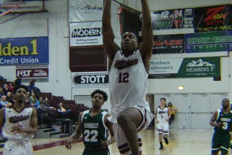 Marvin Timothy slams the ball in against Humboldt State Saturday night. Photo credit: Mathew Boe