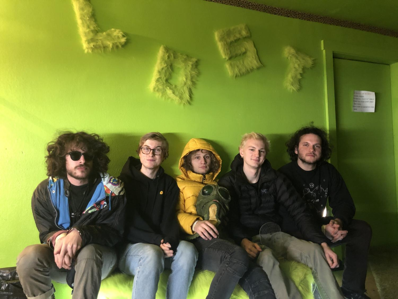 Thumpasaurus members in the green room of Lost on Main