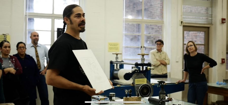 Jacob Meders giving an explanation to the crowd during his printmaking workshop. Photo credit: Melissa Herrera