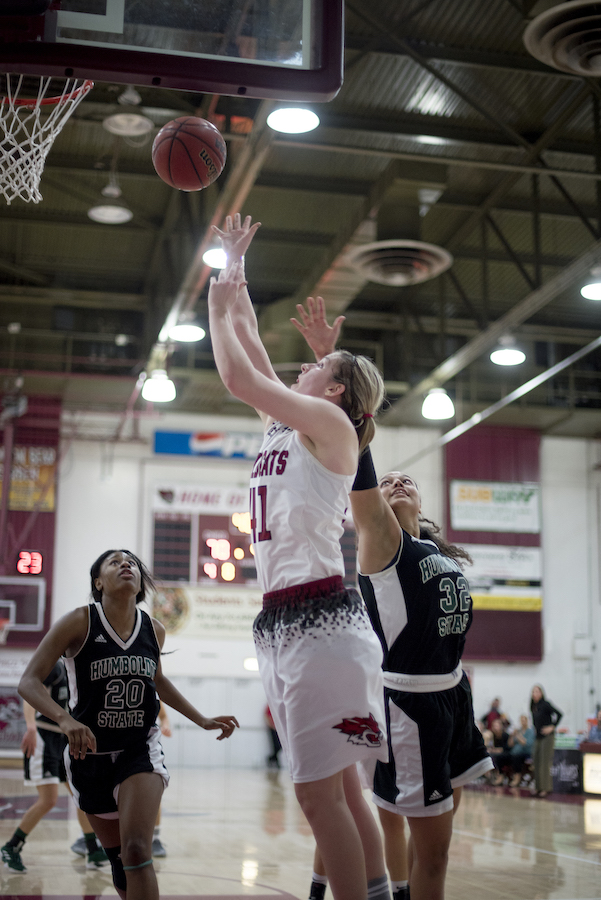McKena Barker shoots a layup against Humboldt State.  Image credit: Jessica Bartlett/University Photographer