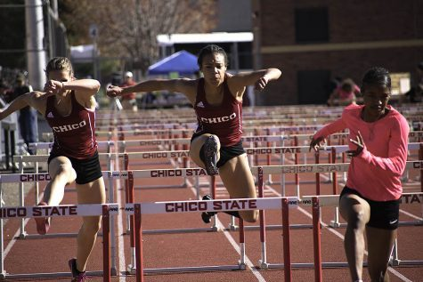 Michelle Holt competing in the 100 hurdles at the 2018 Wildcat invite on March 10. Photo credit: Martin Chang