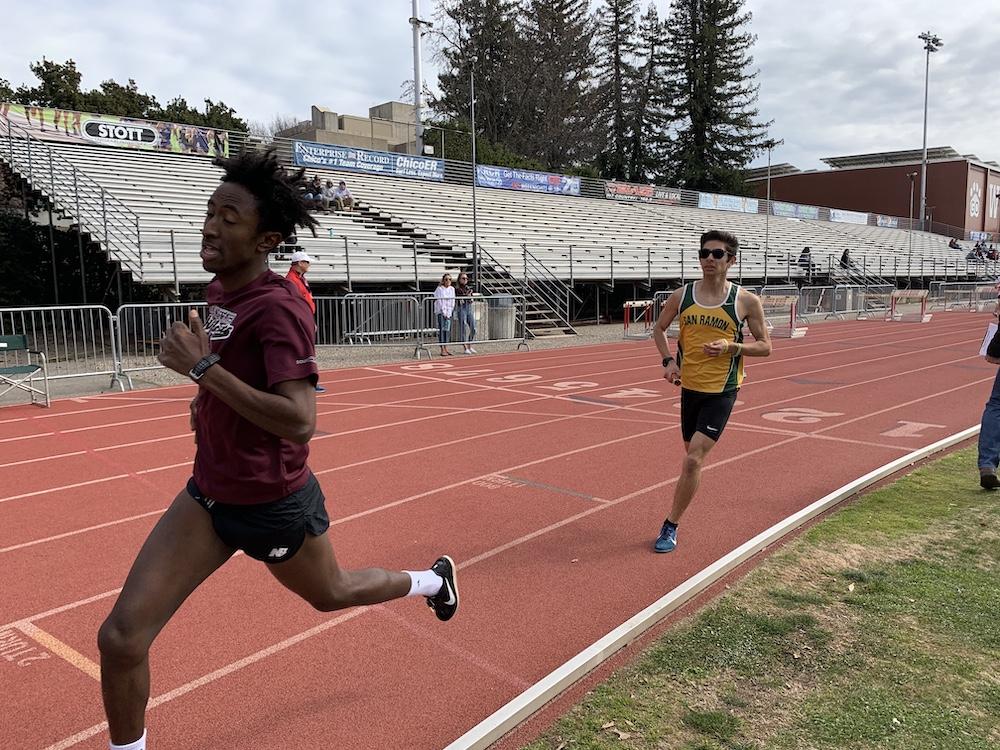 Teddy Kassa followed by Jason Intravaia in the distance medley relay. Photo credit: Lucero Del Rayo-Nava