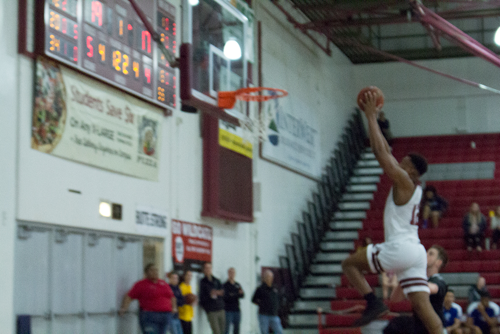 Marvin Timothy goes up for the slam. Photo credit: Mathew Boe