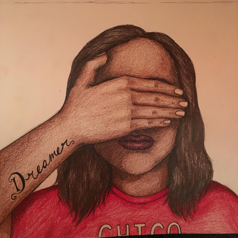 A student hides her face. Photo credit: Melissa Joseph