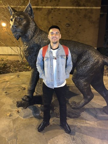 Tweeter Brian Maciel stands in front of the new wildcat statue. Image curtesy of Moises Mendoza.