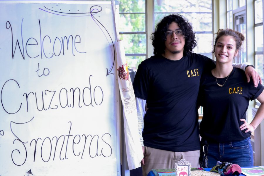 C.A.F.E. members, David Cruz and Rose Merry Blanco, stand next to the welcome sign as students enter the event. C.A.F.E. put together their first event of the semester, Friday, Mar. 8, 2019, in Chico, CA. Photo credit: Melissa Herrera