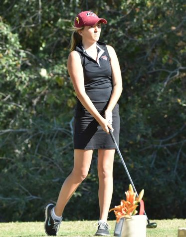 Freshman Julia Kalez watches her tee shot to see where it lands  Image Credit: Chico State Sports Information