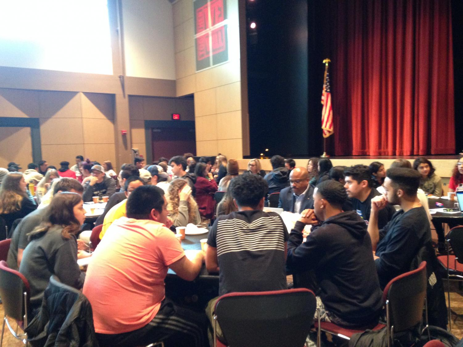 The discussion tables held in the BMU Auditorium.  Students shared their experinces, suggestions and ideas on what can be done to improve safety in the city. Photo credit: Julian Mendoza