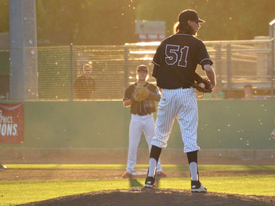 Grant+Larson+stares+down+a+Sonoma+batter%2C+contemplating+which+pitch+he+will+deliver+next+against+the+opposing+batter.+Photo+credit%3A+Olyvia+Simpson
