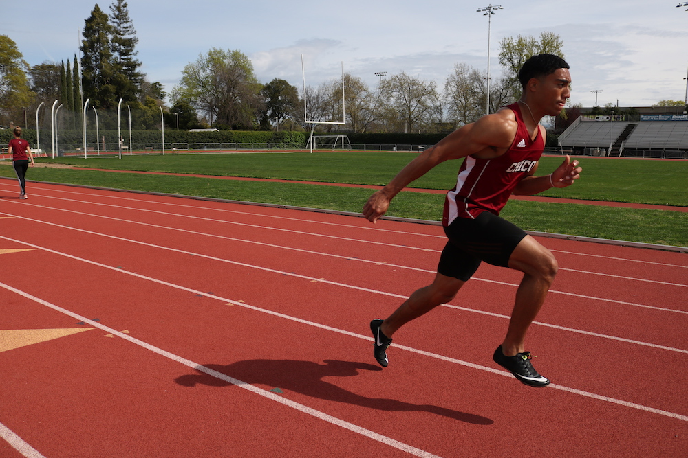 Isaiah Roybal warms up on with the rest of the track team. He is getting ready for their track meet this weekend, Monday, Apr. 1, 2019, in Chico, CA. Photo credit: Melissa Herrera
