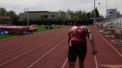 Isaiah Roybal warms up with sprint runs