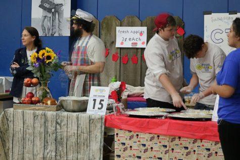 Volunteers set up booths
