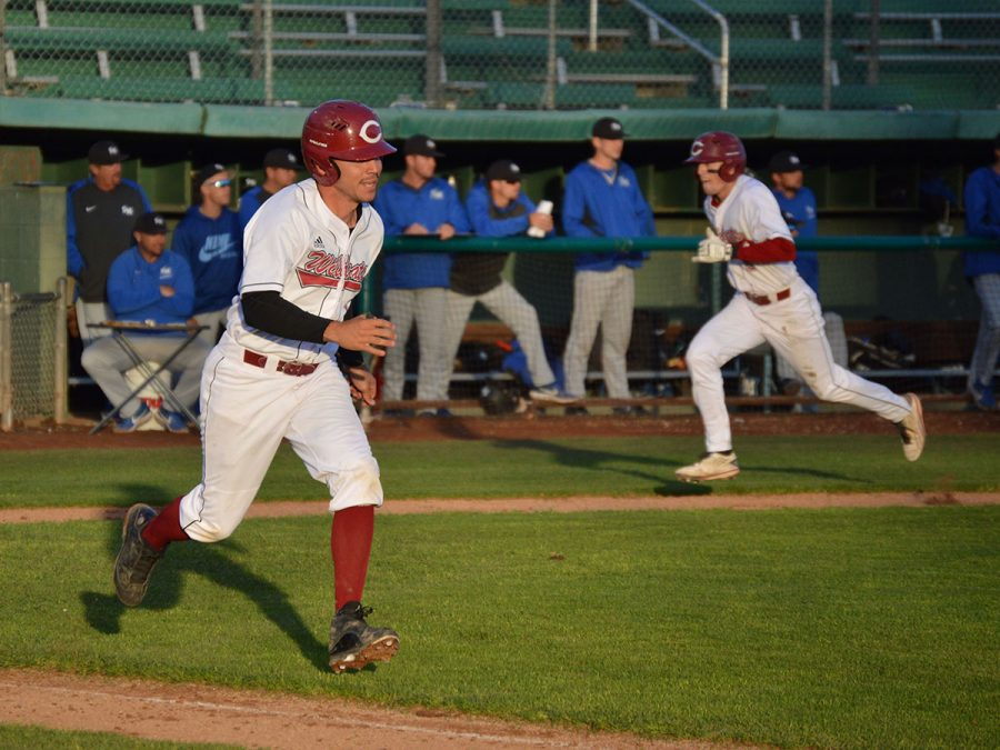 Jorge Perez runs to first as Turner Olson runs home in a game against Cal State San Marcos. Photo credit: Olyvia Simpson