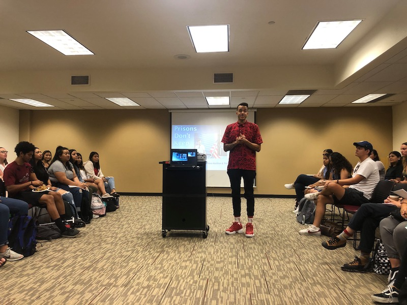 Richie Reseda presents to a full room about his experience in mass incarceration Wednesday. Photo credit: Natalie Hanson