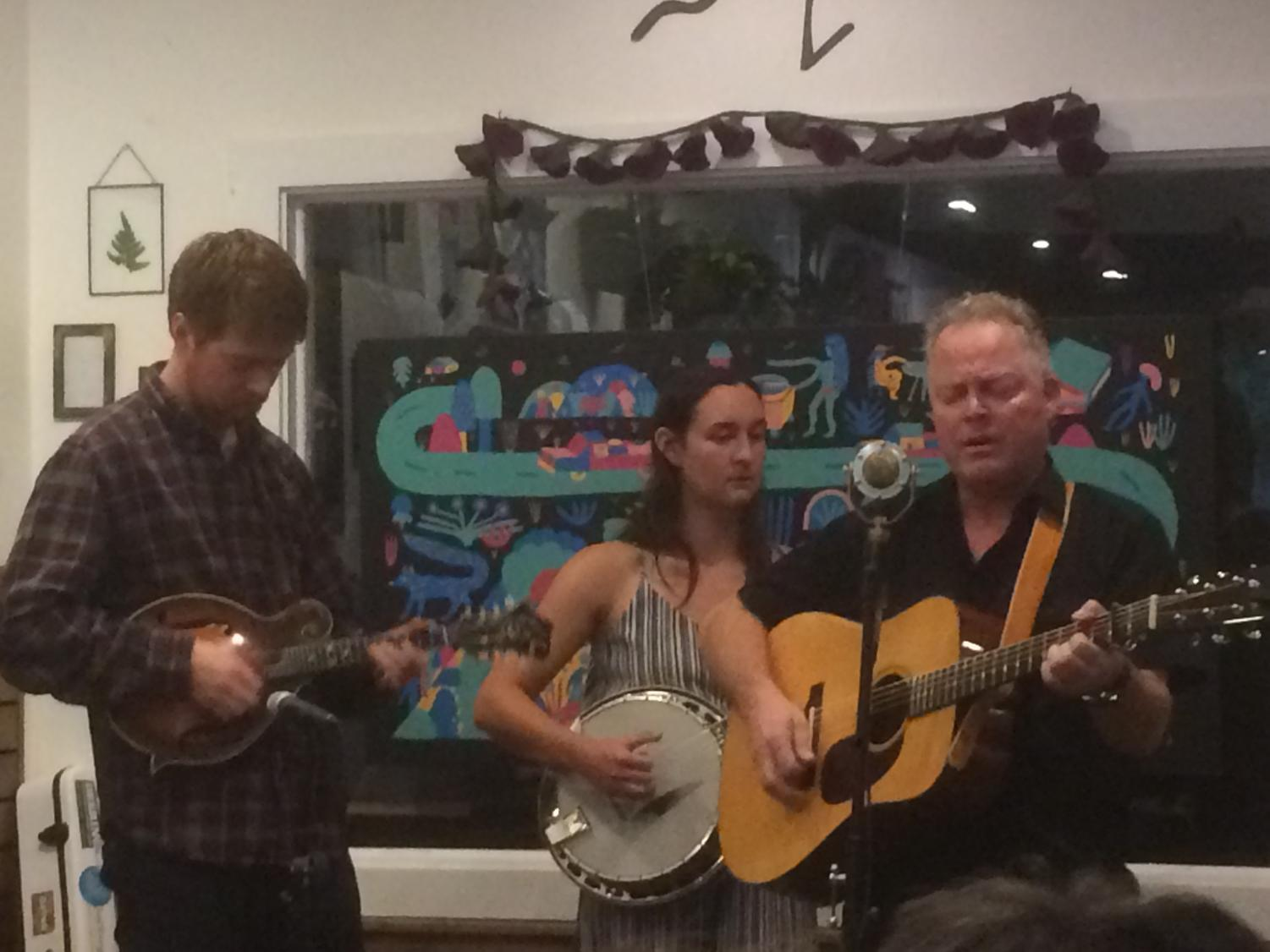 """From left to right David Theissen, Christine Wilhoyte, and Steve Lawson play """"Back to the Bar Room"""" for an enthusiastic crowd at Tender Lovin' Coffee. Photo credit: Emily Neria"""