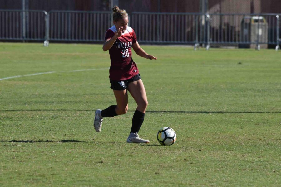 Jordan Doukakis having possession of the ball at home game. Photo Courtesy of Chico State Sports Information.