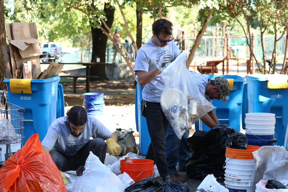 Volunteers grabbed cans, glasses, and other recyclable materials out of bags like these. Photo credit: Melissa Herrera