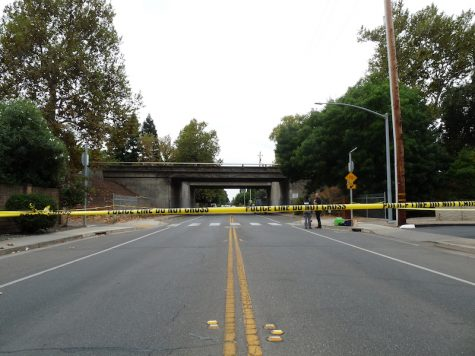The road under the overpass on East Lassen Avenue was blocked off by police tape. Photo credit: Jessie Imhoff
