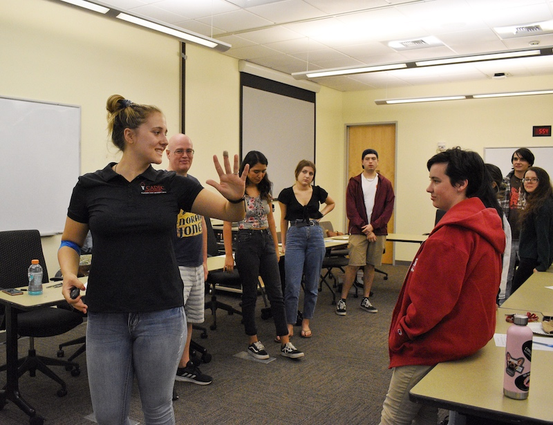 CADEC volunteer, third year Giianna Lagorio leads students through interactive activity,