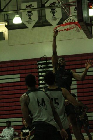 Justin Briggs dunking in Acker Gym. Photo credit: Wesley Harris