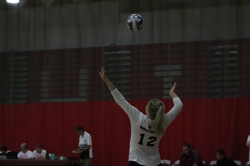 Makaela Keeve serving the ball to the other team. Photo credit: Mary Vogel